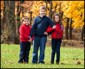 autumn children in red clothes