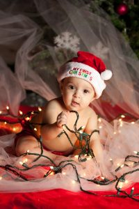 Christmas baby with string of lights
